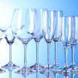 Few empty wine glasses on blue background - Stock Photo
