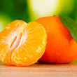 Juicy ripe tangerines with cloves - Stok fotoraf
