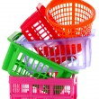 Different plastic baskets isolated on white — Stock Photo