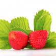 Royalty-Free Stock Photo: Strawberry with green leaves isolated on white