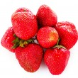 Many strawberries isolated on white — Stock Photo