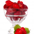 Many strawberries in glass isolated on white — Stock Photo
