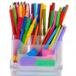 Bright pens, pencils and erasers in holder — Stock Photo