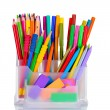 Royalty-Free Stock Photo: Bright pens, pencils and erasers in holder