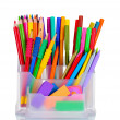 Bright pens, pencils and erasers in holder - Stock Photo