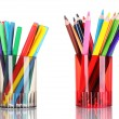 Bright markers and crayons in holders — Stock Photo #6796789