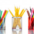 Royalty-Free Stock Photo: Bright markers and crayons in holders