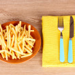French fries and cutlery — Stock Photo