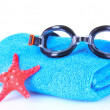 Glasses for swimming and towel — Stock Photo