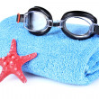 Glasses for swimming and towel — Stock Photo #6797135