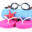 Glasses for swimming, towel and beach shoes — Stock Photo #6797140