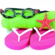 Glasses for swimming, towel and beach shoes — Stock Photo #6797143
