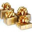 Beautiful golden gifts — Stock Photo