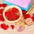 Rose petals, soap, bath salt and towel — Stock Photo #6797905