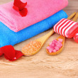 Rose petals, soap, bath salt and towel — Stock Photo #6797909