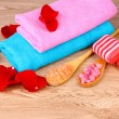 Rose petals, soap, bath salt and towel — Stock Photo #6797910