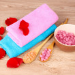 Rose petals, soap, bath salt and towel — Stock Photo #6797911