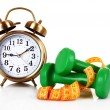 Old alarm-clock, dumbbells and measure tape — Stock Photo