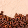 Brown crumpled paper and coffee beans — Stock Photo