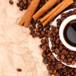 Coffee with cinnamon on paper background — Stock Photo