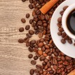 Stock Photo: Coffee with cinnamon on wooden texture background