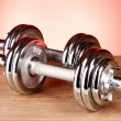 Dumbbell on red background - Stok fotoğraf