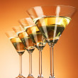 Four martini glasses on yellow background — Stock Photo #6798657