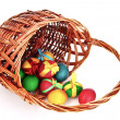 Wicker basket with Easter eggs isolated on white — Stock Photo #6798682