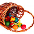 Wicker basket with Easter eggs isolated on white — Stock Photo #6798686