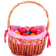 Wicker basket with Easter eggs isolated on white - Lizenzfreies Foto
