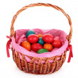 Wicker basket with Easter eggs isolated on white — Stock Photo #6798781