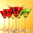 Stock Photo: A few glasses of alcoholic drinks in a yellow-brown background