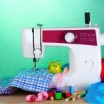 Sewing machine and fabric — Stock Photo