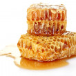 Stock Photo: Combs with honey isolated on white