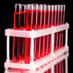 Test-tubes on black background — Stock Photo