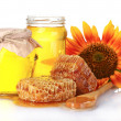 Stock Photo: Beautiful combs, honey, spoon and sunflower