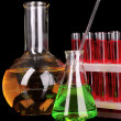 Laboratory glassware on black background — Stockfoto