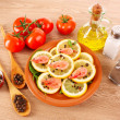 Shrimp on lemons with tomato, peppers and oil on wooden table — Stock Photo #6799100