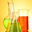 Laboratory glassware on yellow background — Stock Photo #6799245
