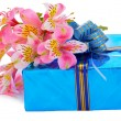 Stock Photo: Beautiful gift and flowers