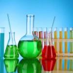 Laboratory glassware on blue background — Stock Photo