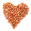 Peanuts in heart symbol isolated on white — Stock Photo