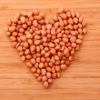 Peanuts in heart simbol — Stock Photo