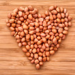 Stock Photo: Peanuts in heart simbol