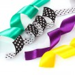 Many beautiful bright satin ribbons — Stock Photo