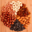 Nuts, raisins and sunflower seeds - Stock Photo