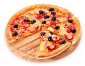 Sliced Pizza with olives on wooden plate isolated on white — Stock Photo