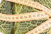 Savoy cabbage and measure tape — Stock Photo