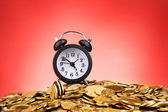Alarm clock and coins on red background — Stock Photo
