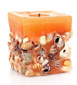 Candle with embedded seashells isolated on white — Stock Photo